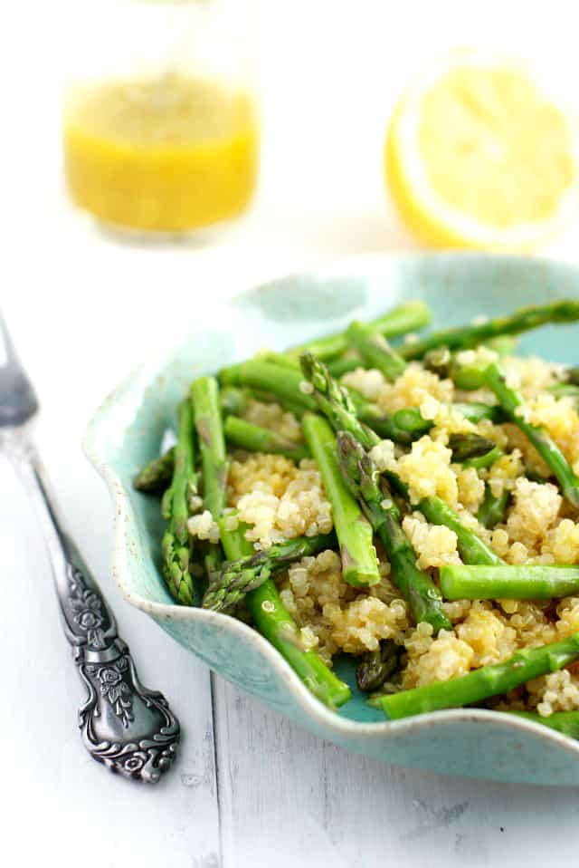 quinoa asparagus salad with lemon dressing in a blue dish