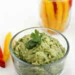 A healthy and tasty snack - white bean and cilantro dip with fresh vegetables for dipping.