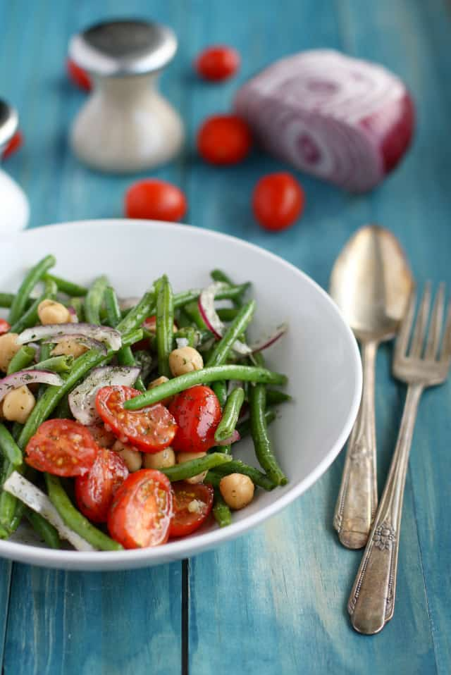 A fresh and coloful green bean salad with tomatoes, onion, and dill. #glutenfree