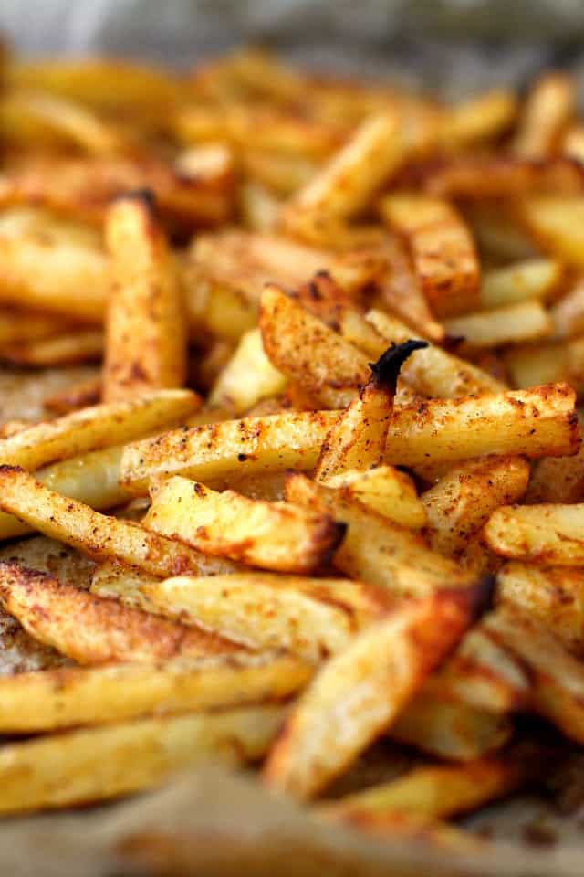 seasoned baked french fries on a cookie sheet