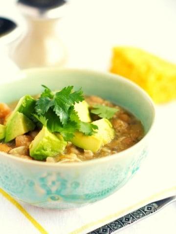 white chicken chili in an aqua bowl