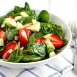 A fresh and delicious spinach strawberry salad with poppy seed dressing. A delicious and easy summer salad.