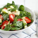 Spinach salad with strawberries, apples, and orange poppy seed vinaigrette. #wholefoods