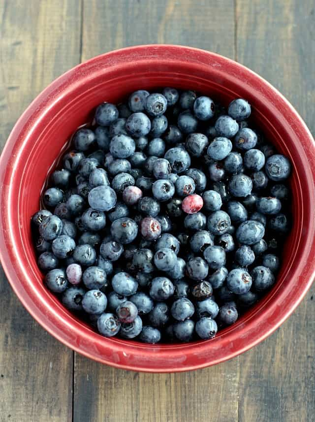 Fresh blueberries in red bowl