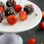 Fresh cherries are dipped in chocolate and sprinkles for an easy and festive treat! #nobake #dessert
