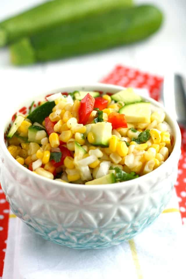 easy summer corn salad in white bowl on a white napkin