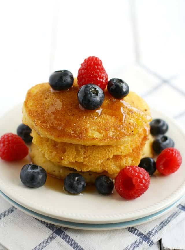 cornmeal pancakes with berries on top
