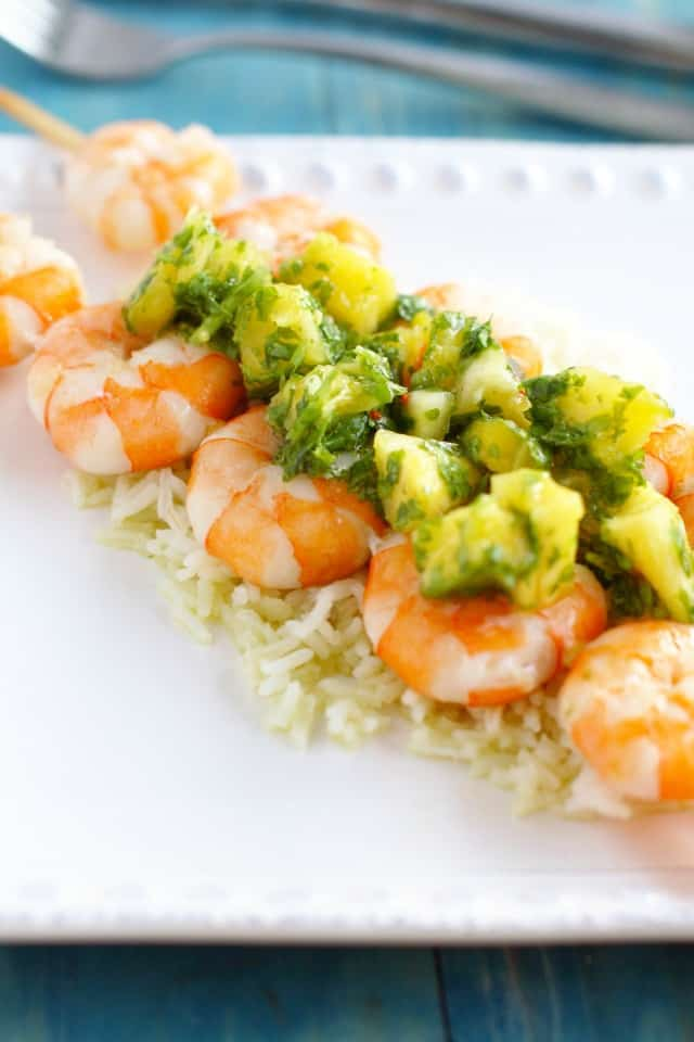 Pineapple chimichurri on grilled shrimp makes a delicious and easy summer meal! Light and flavorful. #shrimp #seafood #glutenfree