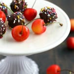 The perfect little bite sized treat for a dessert tray! These cherries are covered in chocolate and sprinkles for a festive sweet treat. #nobake #chocolate