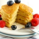vegan cornmeal pancakes on a white plate