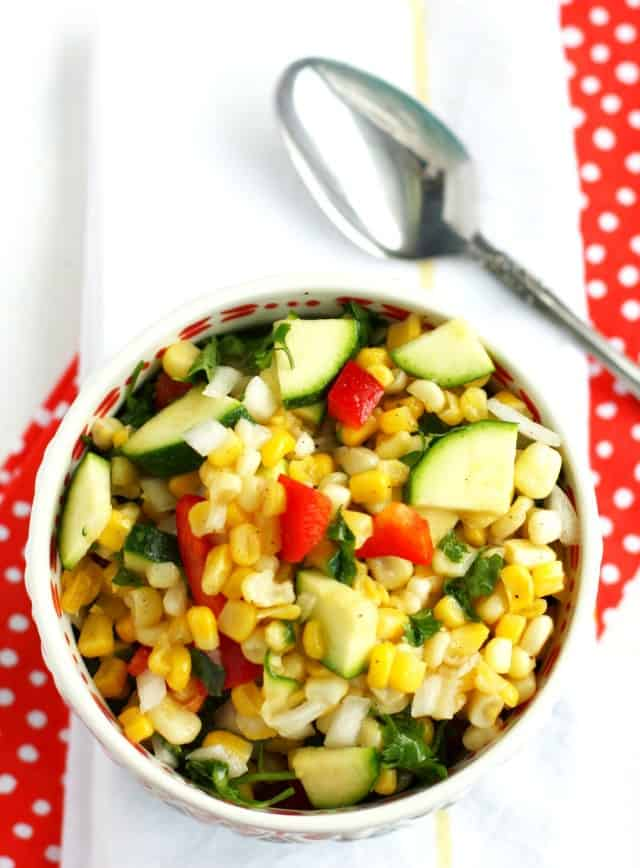 corn and zucchini salad in a white bowl