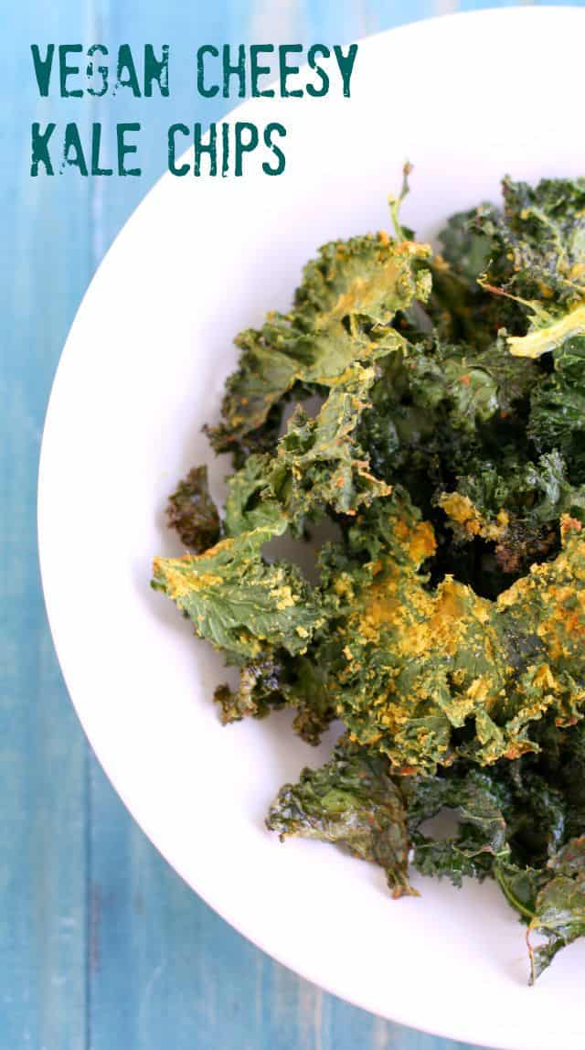 The best vegan cheesy kale chip recipe! These are flavorful and so easy to eat! #vegan #dairyfree #glutenfree #kale