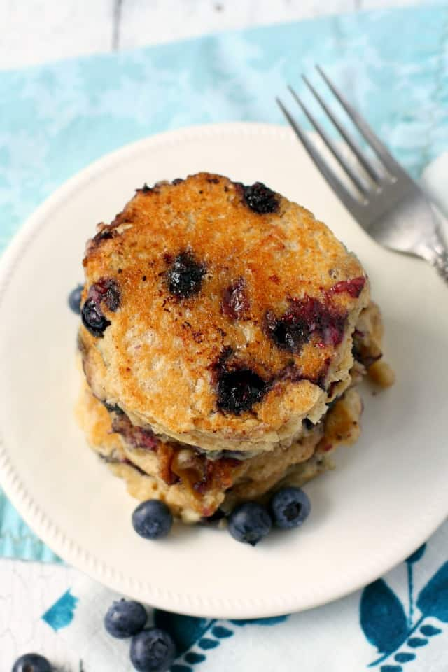vegan blueberry oatmeal pancakes on a white plate