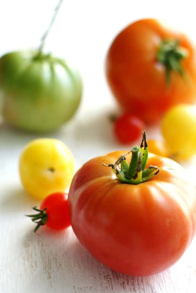 fresh tomatoes on a white background