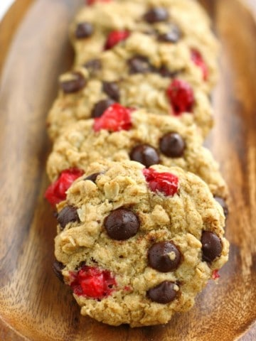 Chewy and delicious chocolate chip oatmeal cookies are made extra festive with the addition of fresh cranberries! Vegan and gluten free recipe.