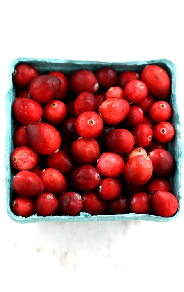 fresh cranberries in a carton