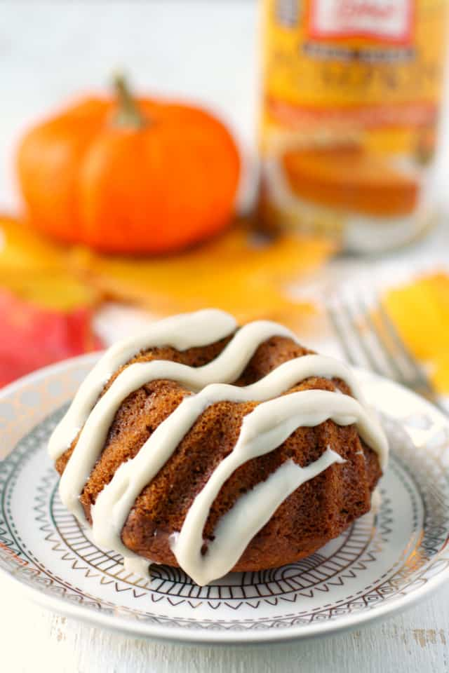 These pumpkin spice mini bundt cakes are so delicious - the sweet cream cheese glaze is the perfect finishing touch! An easy Thanksgiving dessert recipe. #vegan #glutenfree AD #shop