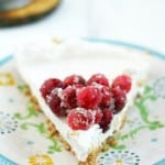 An easy recipe for dairy free cheesecake topped with sugared cranberries and finished with a shortbread crust.