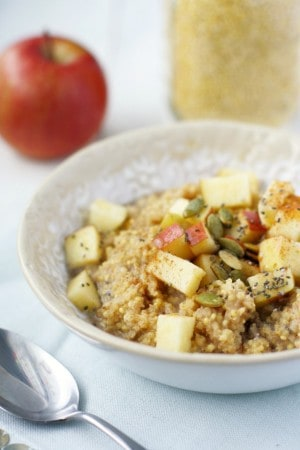 Gluten free millet porridge is topped with a cinnamon apple topping. The perfect cozy breakfast for winter.
