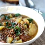 Lentil, sausage, potato, and kale soup made in the slow cooker! Healthy comfort food for winter.