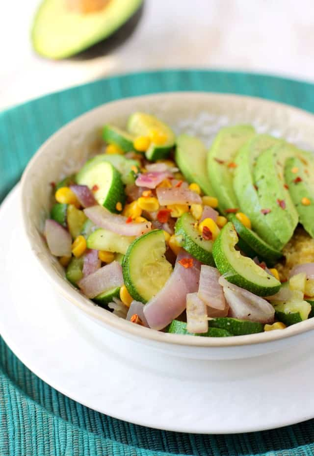 A colorful and flavorful lunch bowl with quinoa, veggies, and avocado. Gluten free and vegan recipe.