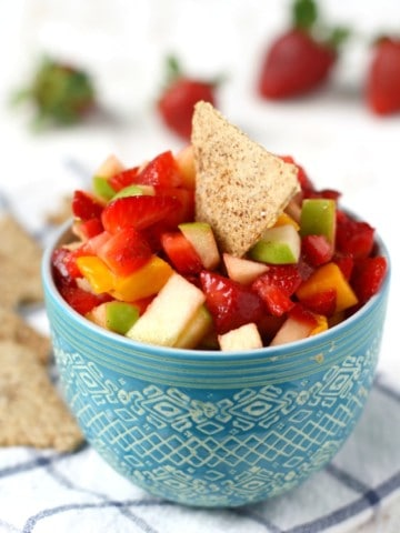 Fresh fruit salsa is a fun and colorful dessert or appetizer for summer! A blend of apples, strawberries, and mango make this salsa a delightful treat!