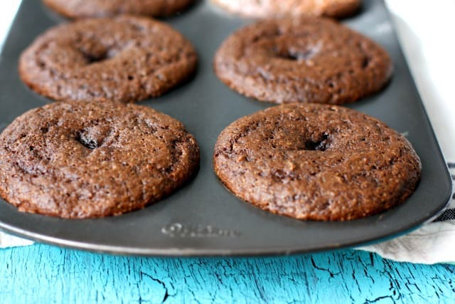baked vegan chocolate donuts in a donut pan
