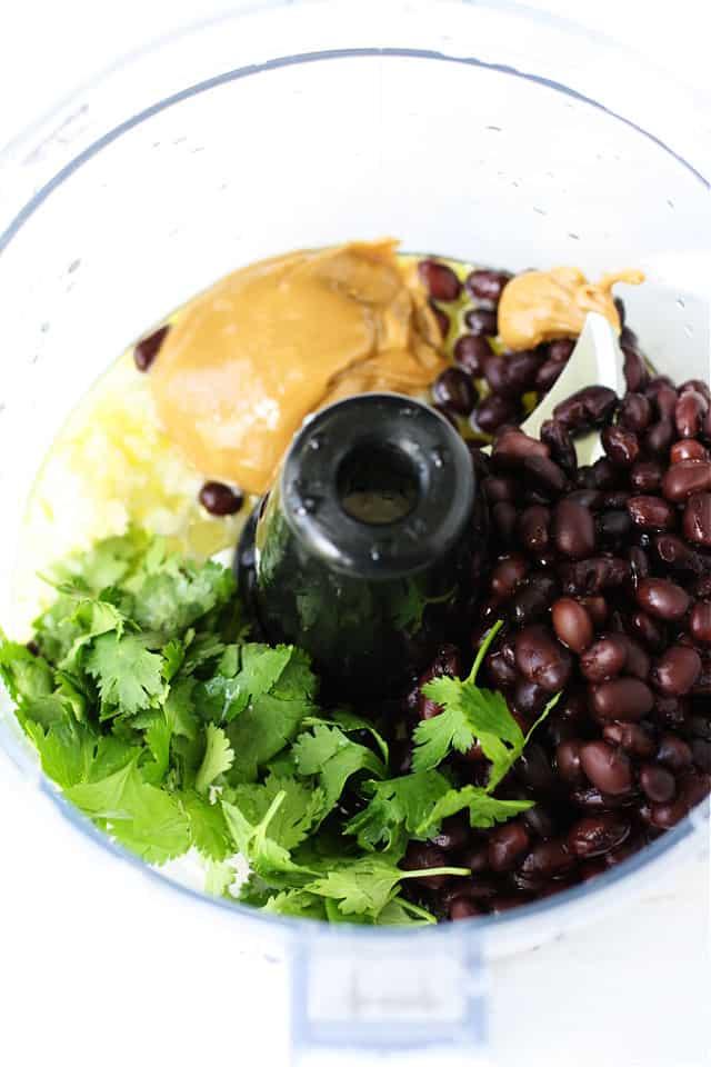 black beans cilantro and garlic in food processor