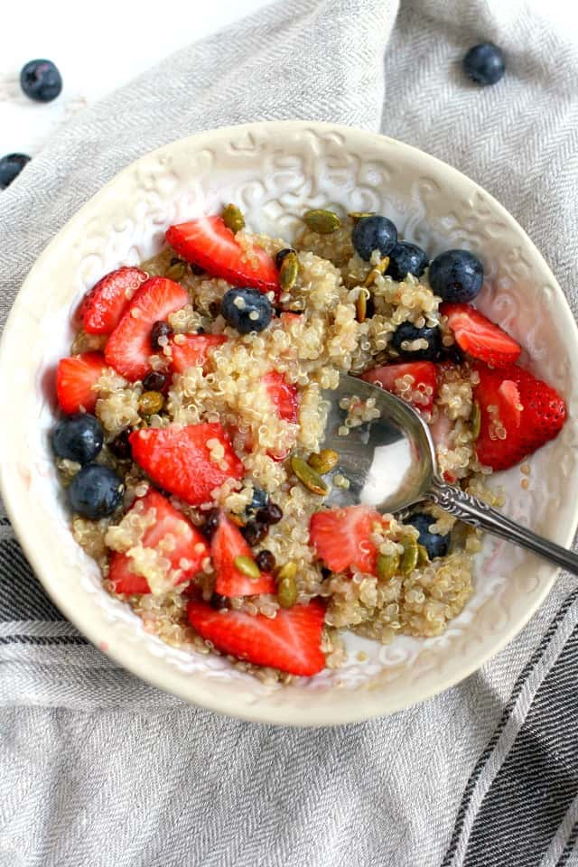 gluten free quinoa porridge in a bowl with berries