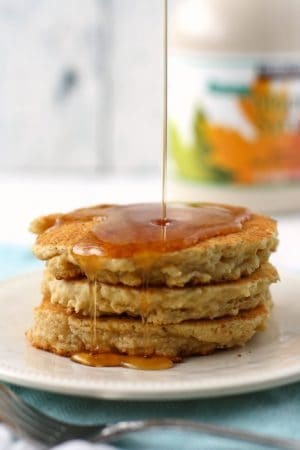 fluffy dairy free pancakes on a plate with maple syrup