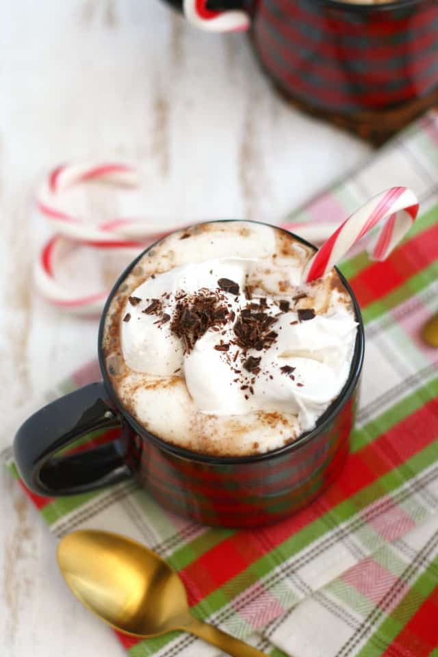 dairy free peppermint hot cocoa topped with whipped cream and candy canes