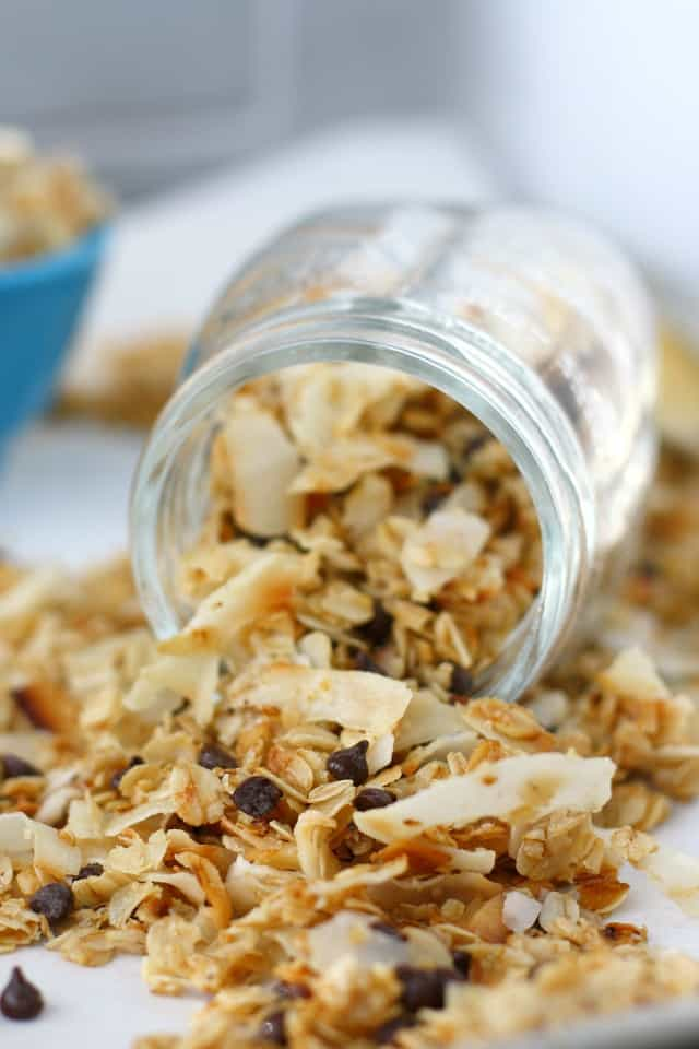coconut granola spilling out of a mason jar