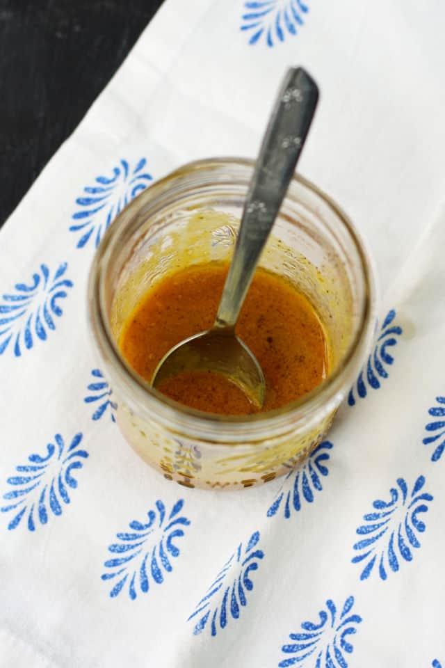 honey mustard dressing in a mason jar