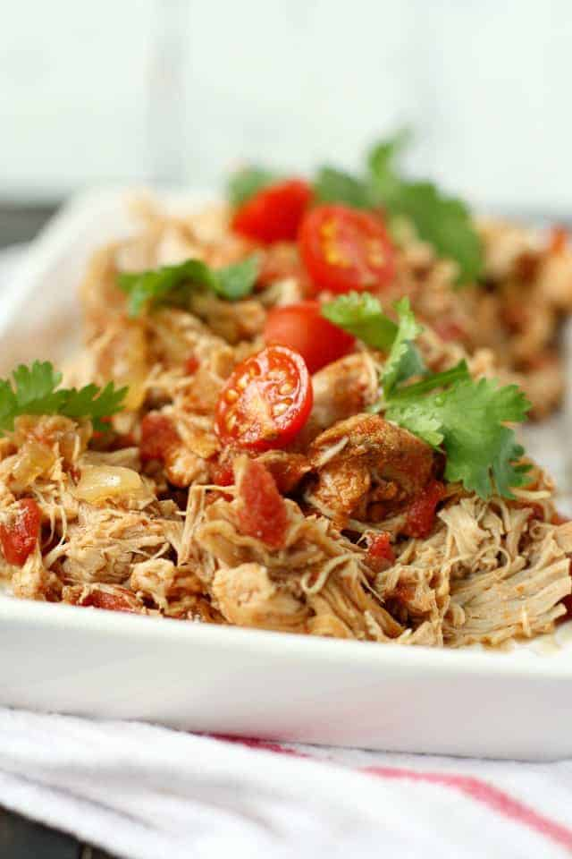 crockpot taco chicken on a white serving dish