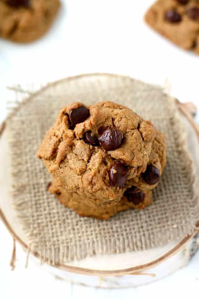 vegan whole grain chocolate chip cookies on a piece of burlap