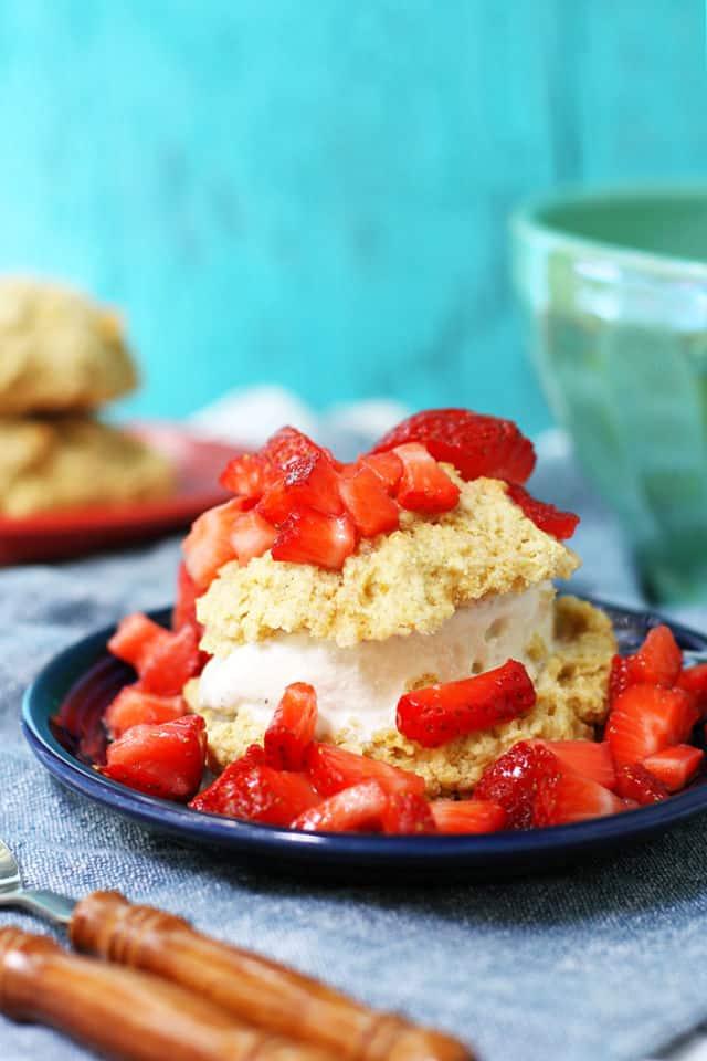 vegan strawberry shortcake on a blue plate