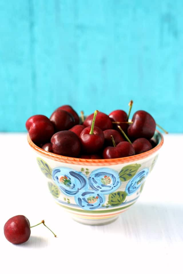 fresh cherries in a ceramic bowl