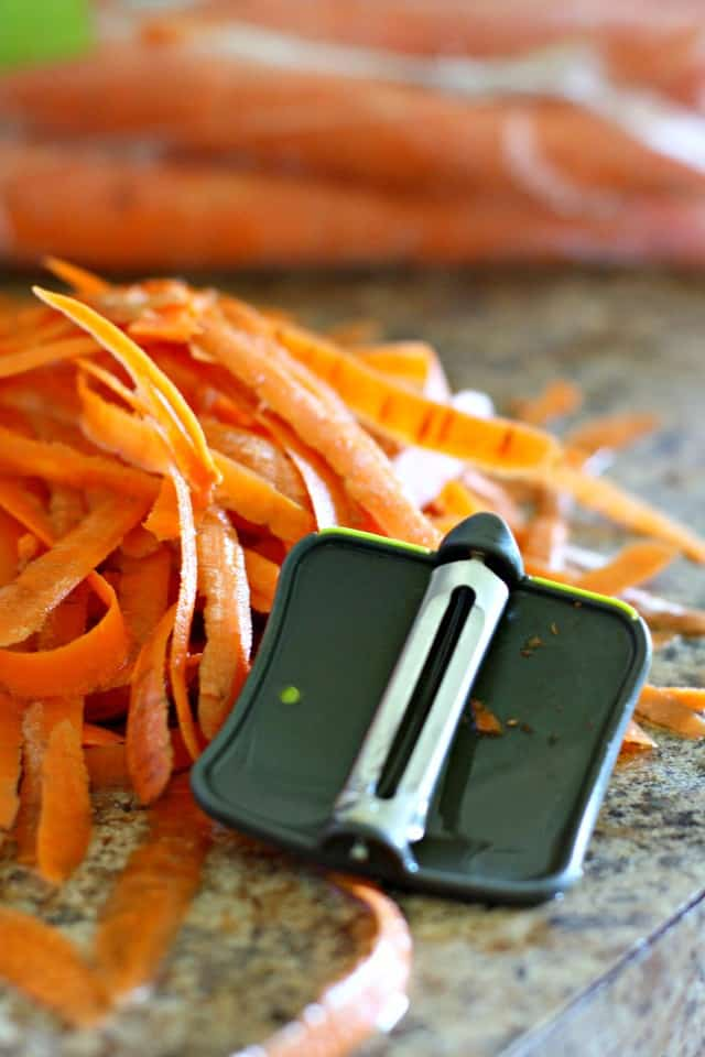 carrot peels and a vegetable peeler