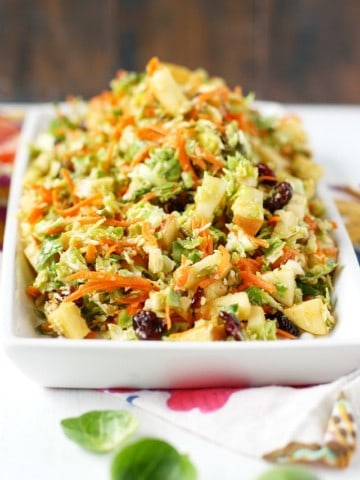 brussels sprout slaw on a white tray