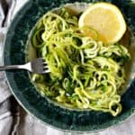 zoodles with lemon and dill in a teal dish