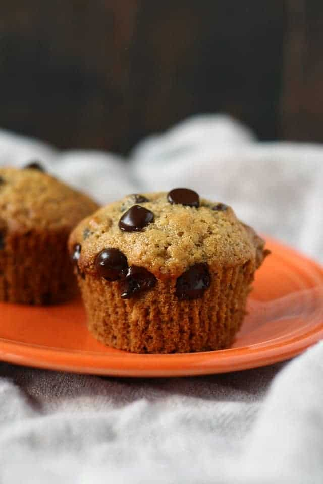 vegan chocolate chip muffins on an orange plate