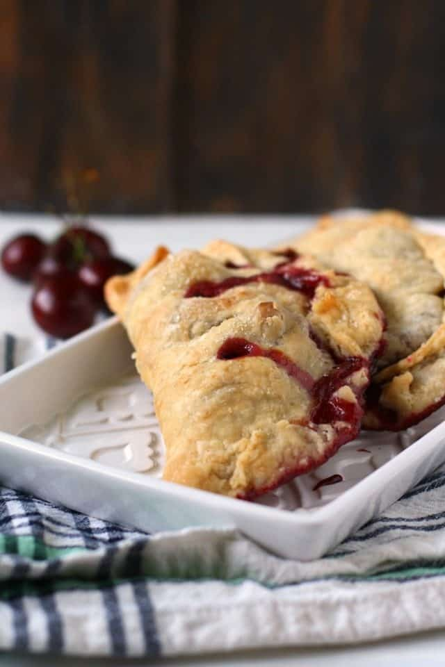 cherry hand pies on a white tray