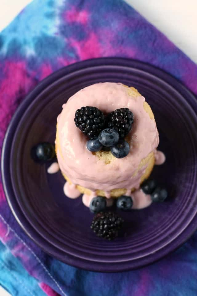 vegan donuts with berries on a purple plate