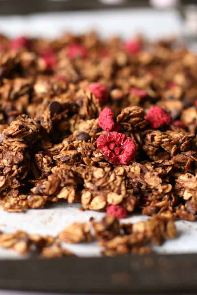 chocolate granola on baking sheet