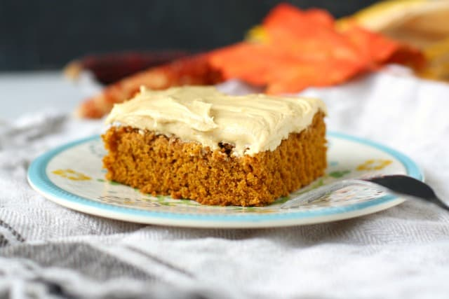 frosted pumpkin spice cake on a plate