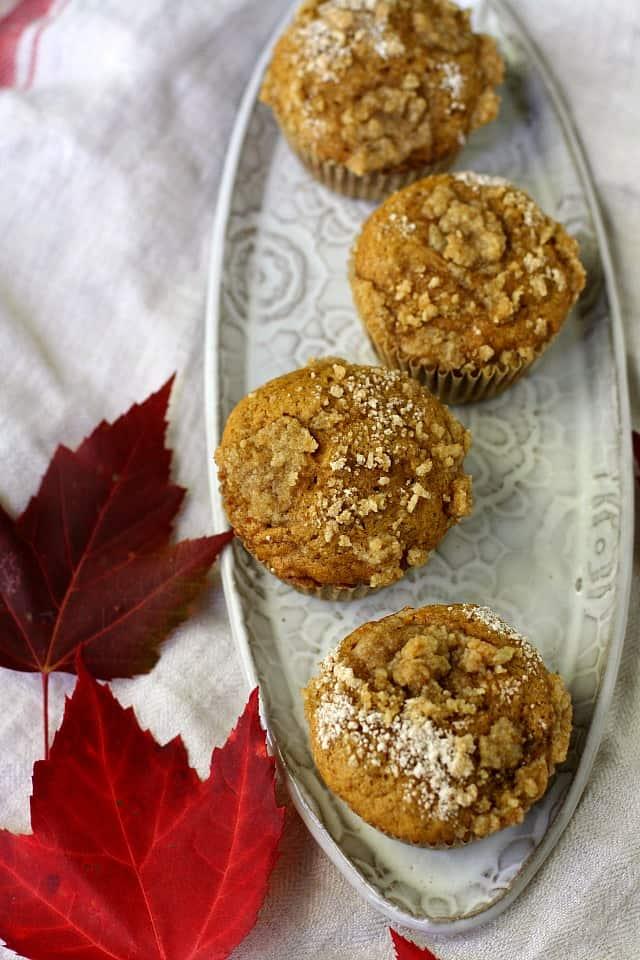vegan pumpkin muffins on a white tray