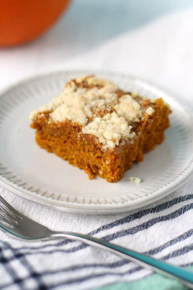 gluten free pumpkin streusel coffee cake on a white plate