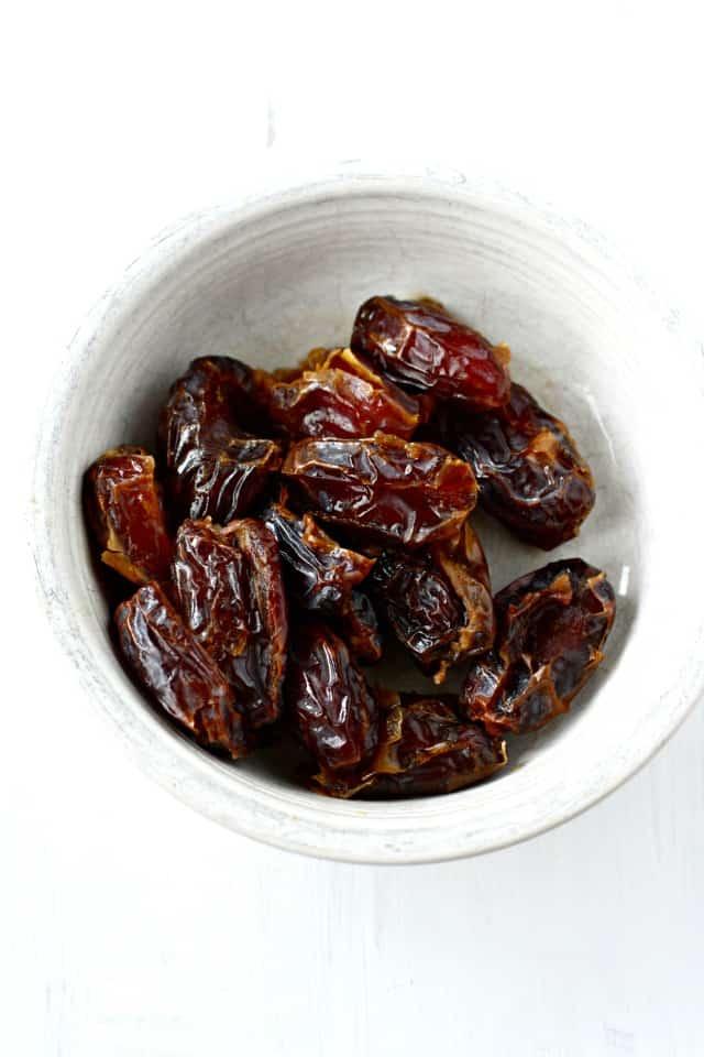medjool dates in white bowl