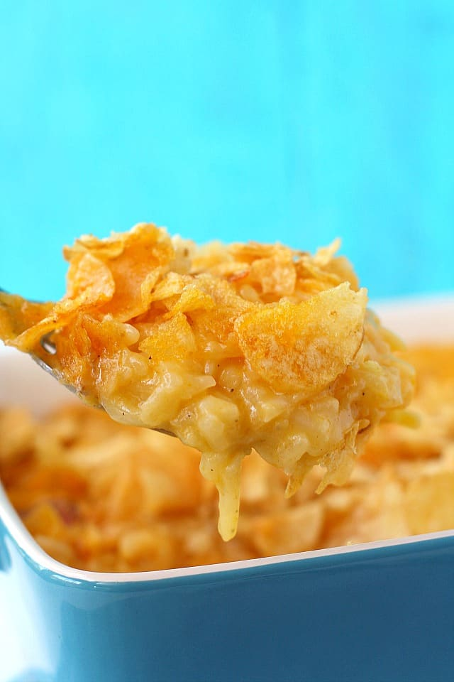 spoonful of cheesy potatoes with potato chips