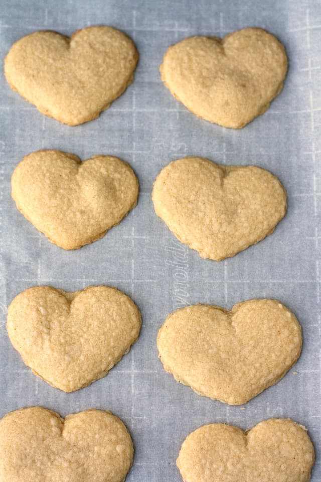 baked shortbread hearts on cookie sheet